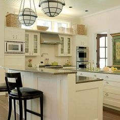 Love the light airy feel and all of the open work space in this kitchen, plus room for the family