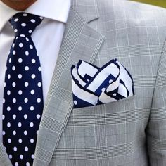 Coordinating polka dot tie and pocket square in navy and white.