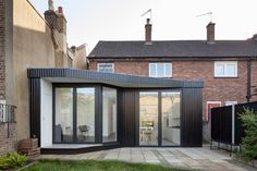 Blackened Timber Extension By Scenario Architecture Features A High Walkway For Cats - http://decor10blog.com/decorating-ideas/blackened-timber-extension-by-scenario-architecture-features-a-high-walkway-for-cats.html