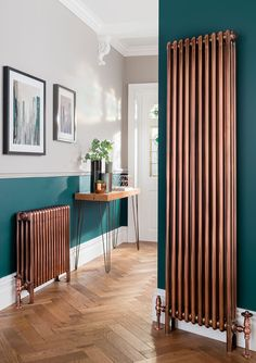 dark flooring The Ultimate Guide to radiator styles for Modern homes need vertical column radiators like this one which is available in satin nickel The Radiator Company. Vertical radiator in a living room with dark floors and white walls, blue armchair Living Room Colors, Living Room Paint, Home Living Room, Living Room Designs, Living Room Decor, Blue Living Room Walls, Colour Schemes For Living Room, Dark Floor Living Room, Interior Paint Colors For Living Room
