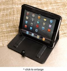 """Our Personalized iPad Case is an attractive, yet safe, way to carry your iPad. Fashioned from soft black vinyl and secured with a sturdy strap, the case's unique design makes it easy to get your iPad in and out  For extra peace of mind, the plaque can be engraved with your name or initials. Measures 7 3/4"""" x 9 3/4"""" x 3/4"""". Personalize with two lines of up to 15 characters per line."""