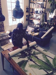 Busi Prepares one of Franco Moz wallpapers for delivery to a client. Summer Paradise, Tropical Leaves, Delivery, Wallpapers, Modern, Design, Home Decor, Trendy Tree, Decoration Home