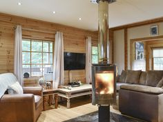 Walkers will love this warm and welcoming lodge with its cosy wood burner. Cosy Lounge, Open Fires, Wood Burner, Cottages, Really Cool Stuff, Woodland, Warm, Living Room, Wood Burning Cook Stove