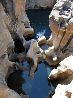 South Africa Bourke's Luck Potholes - Blyde River    The Blyde River Canyon is a significant natural feature of South Africa, located in Mpumalanga, and forming the northern part of the Drakensberg escarpment. It is 26 kilometers in length and about 800 meters deep, mostly consisting of red sandstone. It is the third largest canyon in the world. It is known as one of the great wonders of nature in Africa.