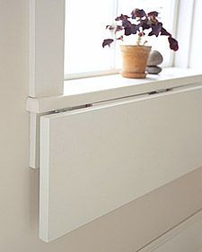 Extend a WindowsillSelect plywood the same thickness as sill; cut it as wide as sill and 12 inches deep. Attach bottom of shelf to bottom of sill with 3 hinges: 1 at the center, the others near the sides.