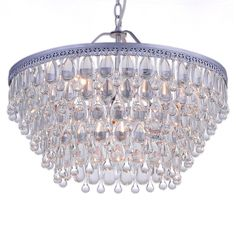 This six-light chandelier is adorned with dozens of clear crystal pieces in teardrop bead forms to allow the light to sparkle. The metallic surface has a pretty matte silver finish for added elegance to indoor decor.
