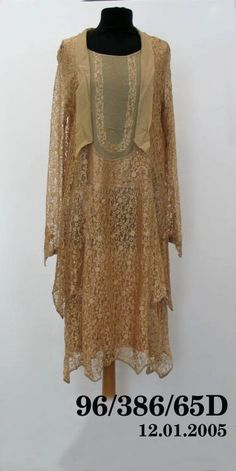 Dress, chiffon/ lace, Australia, 1920-1930  Dress of coffee lace with long sleeves, the front in coffee chiffon with deep revers and matching collar, the hem and cuffs edged in coffee lace rouleaux. Museum Collection, Chiffon, Australia, Lace, Long Sleeve, 1920s, Sleeves, Cuffs, Marketing