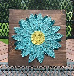 Add this beautiful gerber daisy to your gallery wall or gift it to a friend! Size is 9 by 9. You choose the wood stain (gray, dark brown, light brown, aqua, or white) and string colors (please add a note). A sawtooth hanger is added to every board. Shipping overages will be refunded. Thank you for checking out my listing! You can find more at my Etsy shop- www.KiwiStrings.etsy.com