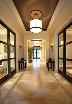 Transitional entry by Parkyn Design.  Love the hallway's effect that looks like mirrored walls.