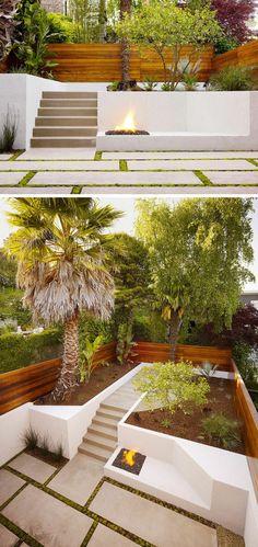 terrasse sur terrain en pente, marches en pierre, dallage sol assorti, foyer extérieur et palmiers géants