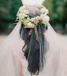 Light flower crown on a dark wavy hair, with a see-through dreamy veil is perfection <3