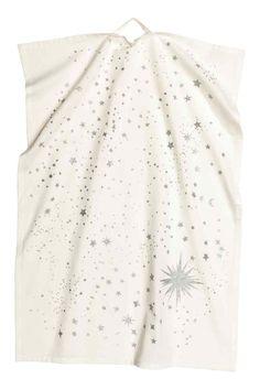 Christmas-motif tea towel: Cotton tea towel with a glittery star print. Hanger on one short side.