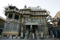 """Facade of the """"Porcelain House"""", built by Chinese collector Zhang Lianzhi, on November 2008 in the Heping district of Tianjin, China. Antique China Dishes, Crazy Home, China World, French Style Homes, Chinese Architecture, Unique Architecture, Unique Buildings, Tianjin, House Built"""