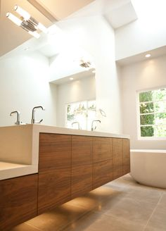 A wall mounted vanity might be nice- adds a good spot for slippers/ a scale etc. and adds to a feeling of spaciousness