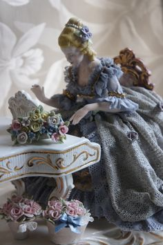 .Porcelain piano with young lady at keyboard.