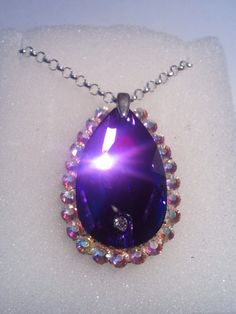 """I made this for my niece to replicate her """"amliet"""" {sic} from her favorite story book character.  The main stone is Swarovski with Preciosa stones around the outside."""