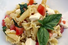 olive oil, butter, tomatoes, basil and fresh mozerella. simple and delish.