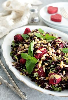 Vegan black rice and raspberry salad with sprouts, mint, and a sweet mustard dressing is bright, fresh and incredibly healthy.