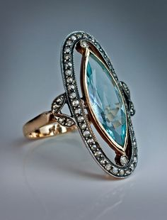 An Edwardian Era Antique Aquamarine and Diamond Long Ring circa 1910