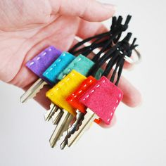 project // tumbler-shaped rainbow felt key covers