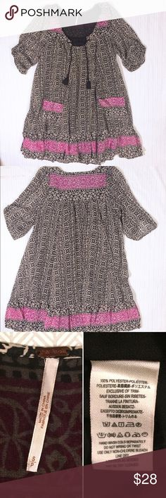 Free People Printed Tunic Flowy printed tunic mini from Free People. Black, white and purple with tassel ties at the neck. Slightly longer in the back than the front. Runs a bit large, but drapes well. In good used condition with some snags at the chest (see last picture). Price reflects these flaws. Free People Dresses Mini