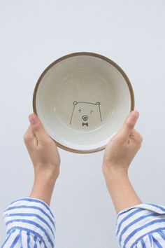 these bear bowls have sold but you could easily create this on your own with ceramic bowls, an oven, and a sharpie.