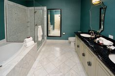 Our spa-like bath in each guest room features revitalizing shower heads, glass enclosed showers, huge tubs, and all the spa lotions, hair products, and soaps needed during your stay.  ~ Woolley's Classic Suites, Denver Airport.