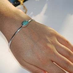 silver bangle with turquoise stone
