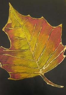 mrspicasso's art room: October 2009  uses glue on black smooth paper and metallic markers over glue/ interior of leaf are 3 chalk pastels.
