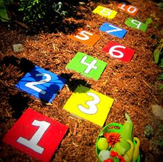 Hopscotch stepping stones as DIY garden art!  My grandboys will love this idea for our garden..