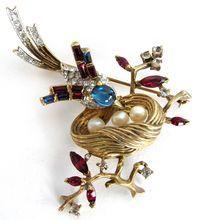 Trifari vintage rhinestone bird and nest pin in patriotic colors.