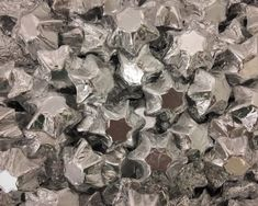 A bulk Foiled Chocolate Stars Silver box.