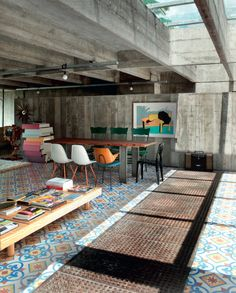 Colourful tiles brighten up this concrete loft in São Paulo, Brazil.