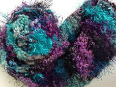 Cowl  by StitchesnQuilts on Etsy knit with art yarn by Kitty Grrlz Handspun Yarns
