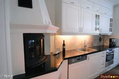 I really love the idea of this subtle, built in fireplace in the kitchen:D