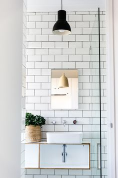 white subway tiles and black hanging pendant light