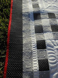 like the squared spirals - so much to admire in this quilt