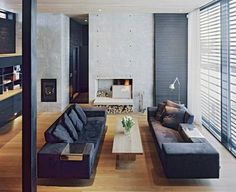 living-rooms-black-gray-coffee-tables-fireplaces-open-floor-plans-open-shelving-shutters