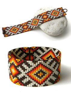 Colorful beadwoven bracelet - ethnic style beadwork jewelry - bead loom bracelet -beaded cuff https://www.etsy.com/listing/212375870/colorful-beadwoven-bracelet-ethnic-style