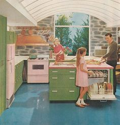 A lovely vintage kitchen with pink Whirlpool appliances... and green steel cabinets...