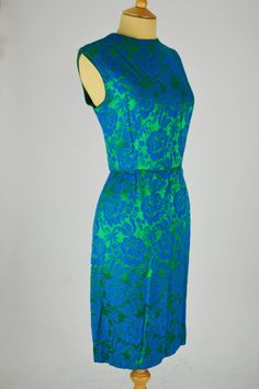 Mela Mela Vintage is pleased to offer this gorgeous vintage dress by Blanes in green with a blue floral design. Green With Blue, Vintage Dresses, 1960s, Floral Design, High Neck Dress, Collection, Fashion, Vintage Gowns, Turtleneck Dress