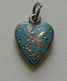 Victorian Enameled Butterfly Sterling Heart Charm ~ This made me think of you right away.  If I could, I'd get you a charm bracelet and fill it with nothing but Guilloche butterfly charms.  Some day. :)