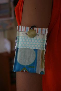 DIY iPod case for your arm made from fabric scraps.    http://oneshabbychick.typepad.com/one_shabby_chick/2011/01/an-ipad-cover-tutorial.html