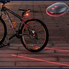 Get where you're going safely! This LED and red laser beam bicycle safety light creates a virtual lane around your bike to help protect you while you bike at night. Not only is it cool looking, you'll never have to worry about not being seen at night (or not being able to see where you're going on unlit streets). It features a bright flashing light as well as a highly-visible laser lane to draw maximum attention to your presence and position.