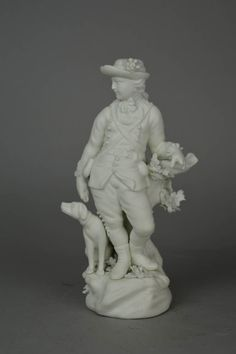 Figure; biscuit porcelain; sportsman; dog at his side; carrying a gun.