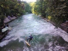 Surfing on the Isar River in Munich, Germany