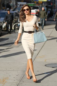 V-neck high cut pencil dress for Work.  Mid heel Court shoes. Day bag.  All Neutral, jewel & berry tones.