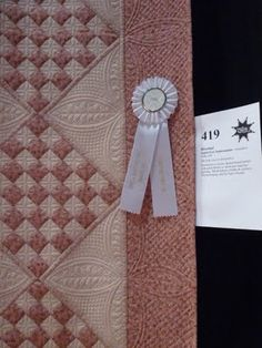 """""""This is Janet-Lee Santeusanio's Rosebud quilt. It's simple, classic piecing, and typically Janet-Lee lovely quilting."""""""