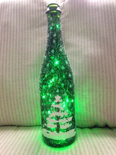 Hand painted christmas tree on green bottle with glittler and green lights on Etsy, $23.00