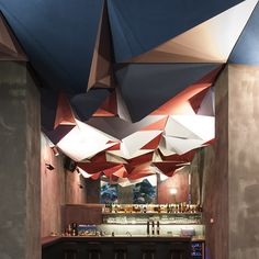 Local architects Gregorio S. Lubroth and Chieh-shu Tzou teamed up with three friends to design, build and launch the bar themselves, before adding the spiky ceiling as the first in a series of installations by different artists and designers.